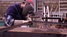 worker doing metalworking using a grinding wheel, slider shot Footage