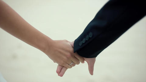 Young Couple Holding Hands Yellow Sand in Background Footage