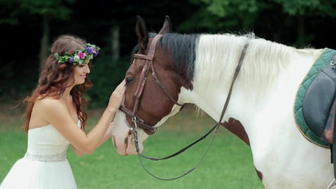 Pretty Girl Lovingly Petting Her Beautiful Horse Footage
