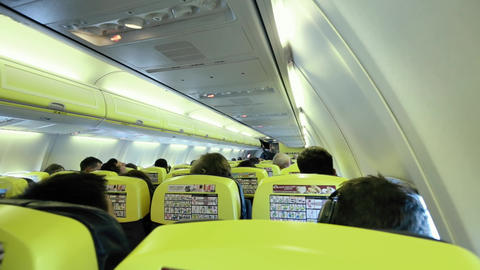 Airplane Passenger Cabin With People stock footage