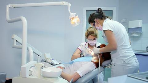Female Dentist Treats Teeth of Woman Stock Video Footage
