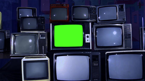 Old Tv with Green Screen and Many Old Tvs. Aesthetics of the 80s. Zoom Out Live Action
