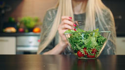 Glad woman eating healthy salad. Beautiful young female enjoying healthy Footage