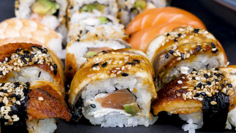 Close up dolly slide shot of traditional delicious sushi rolls Footage