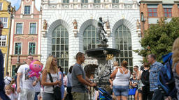 Gdansk, Poland. Old Town. Neptune fountain and strolling tourists Live Action