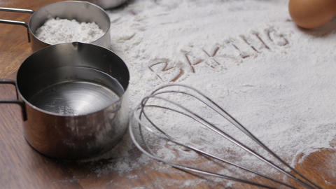 Pastry Baking Accessories Bakery Background with baking text writing on flour. Live Action