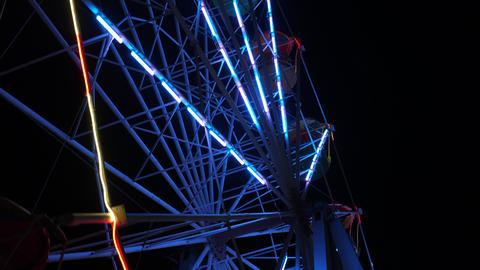 Part of ferris wheel Lighted details is spinning at night with stop motion Live Action
