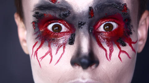 Halloween. Eyes in makeup. Blood Live Action