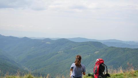 Hiking - hiker man on trek with backpack living healthy... Stock Video Footage