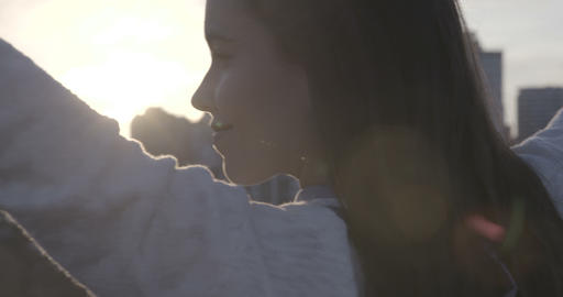 Woman Enjoying Sunrise On Rooftop – 4K Live Action