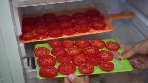 Frozen Tomatoes. Freezer Cooking Footage