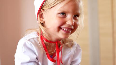 Portrait of smiling girl in doctor's clothes Footage