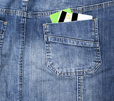 plastic credit card in the back pocket of the jeans フォト