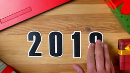 Illustration, new year, male hand put on the table on 2018 date, changed on 2019 Footage