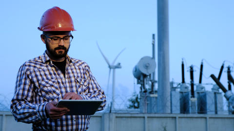 An electrical engineer in the evening at the substation Footage
