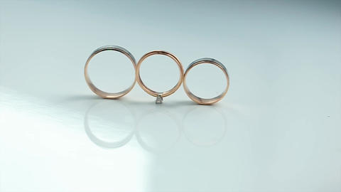 Gold Rings are on a White Background Live Action