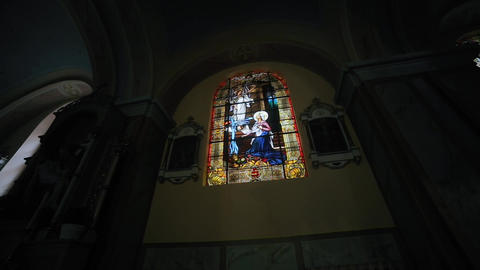 Religious stained glass window on image angel and Woman Footage