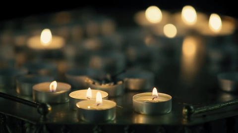Many Candles are Lit in the Temple Church Footage