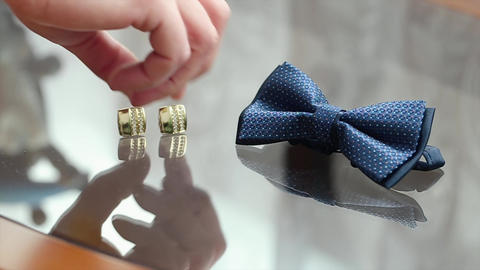 Bowtie and Gold Cufflinks Lying On a Glass Table Footage