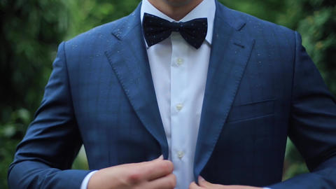 [alt video] Buttoning a Jacket. Stylish Man in a Suit Fastening...