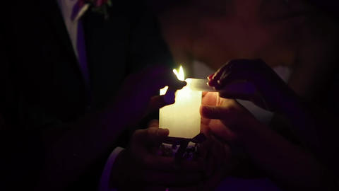 Bride and Groom are Holding a Burning Candle Footage