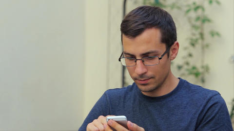Turns Man Page Browser on the Phone in White, close-up Footage