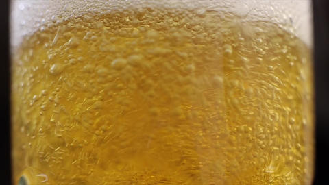 Beer Bubbles Rise the Glass a Moving Light Source Live Action