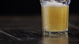 Beer being Poured into a Glass at Slowmotion Footage