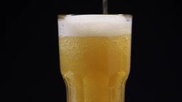 A Mug of Beer on a Black Background Live Action