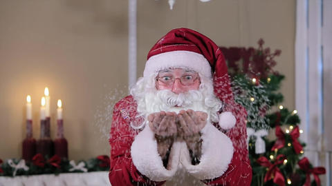 Santa Blowing Snow Indoors to Camera, Room with Fireplace and Christmas Tree, Gi Footage