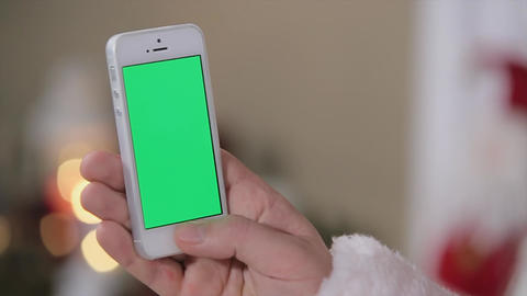 Santa Hold Smartphone in Hand Chroma Key. Smartphone with Green Screen in Vertic Footage