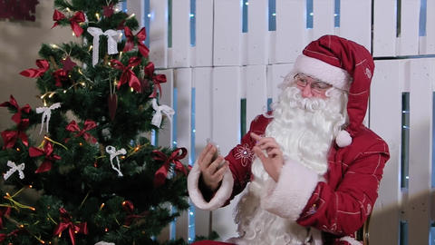 Santa Claus Is Sit and Talking His Phone, Room with Fireplace and Christmas Tree Footage