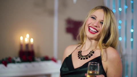 Young Beautiful Blonde Woman in Evening Dress with beautiful make-up and manicur Footage