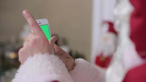 Santa Claus Using Smartphone With Green Screen. Smartphone With Green Screen In  stock footage