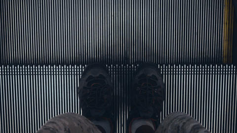 Man Feet On Moving Escalators In Modern Urban Interior stock footage