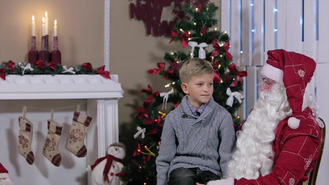 Santa and Little Boy Talk About Gifts Footage