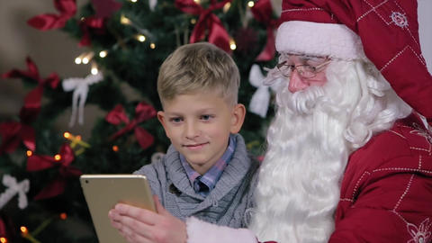 Santa and Boy Chosen to Present The Internet Digital Tablet Footage