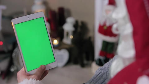 Santa and Little Boy Choose Gifts on Tablet. Tablet with Green Screen in Vertica Footage