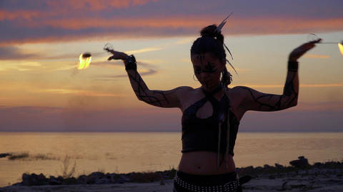 Wild looking lady is dancing on the sunset Stock Video Footage