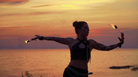 Wild looking lady is dancing on the sunset Footage