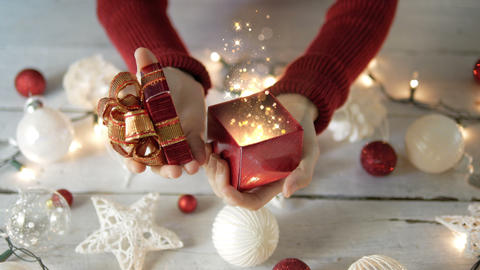 Woman open the gift box with gold lights magic with Christmas decoration Live Action