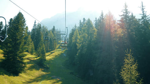 use a chairlift to approach the mountain to make trekking in the Alps GIF
