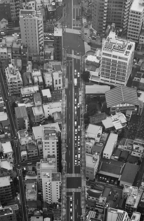 Buildings and traffic in downtown city black and white theme フォト