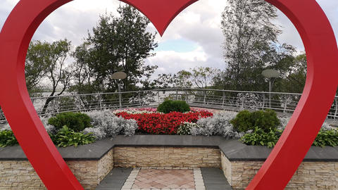 Wedding arch in the form of red heart. Wedding background. Wedding decoration. D Live Action