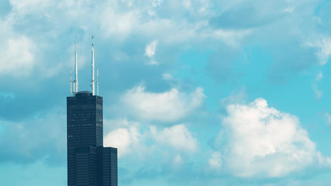 Time-lapse of Chicago's Willis Tower aka Sears Tower with puffy clouds Live Action