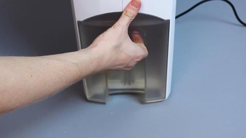 Presentation of modern air humidifier, household moisturizing appliance showcase Footage