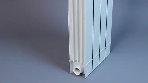 Vertical panorama of a household hot water radiator, heat-saving technology Footage