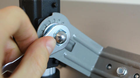 Close-up of hands tightening nut fastener with a hexagonal ratchet wrench Live Action