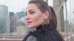 Close up portrait of beautiful Woman On Brooklyn Bridge In New York Footage