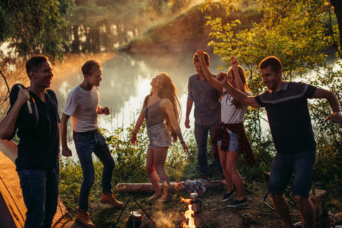 attractive active tourists are orginizing an open air disco Photo